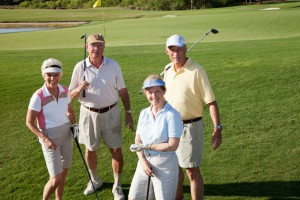 Two senior couples playing golf